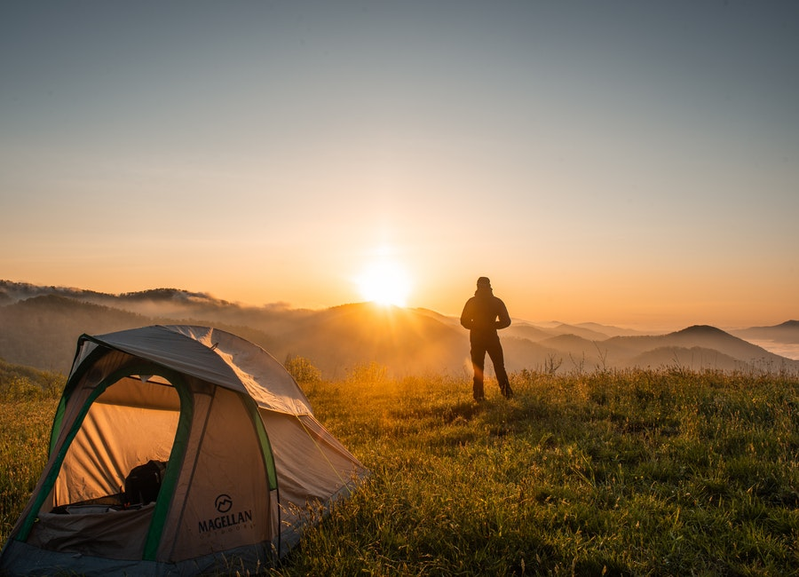 A man see sunrise in his adventure tour arrnaged by best travel agency
